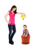 Mother watering baby in flower pot Royalty Free Stock Photography