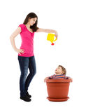 Mother watering baby in flower pot Royalty Free Stock Image