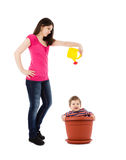 Mother watering baby in flower pot Stock Image