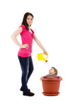 Mother watering baby in flower pot Stock Photo