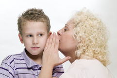 Mother whisper to the son Stock Photos