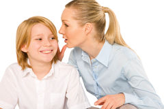 Mother whispering to son close up Royalty Free Stock Photography