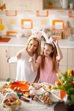 Mother whith daughter making selfi while painting eggs royalty free stock images