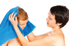 Mother wipes head to his son after bathing Stock Photography