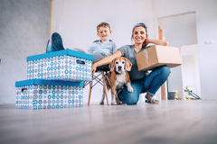 Mother wit son and dog in new apartment Royalty Free Stock Photography
