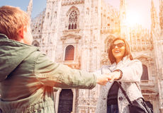 Mother wit son take for hands on the squere near Duomo di Milano Royalty Free Stock Photo