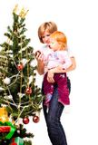 Mother With A Son Near A New-year Tree Royalty Free Stock Images