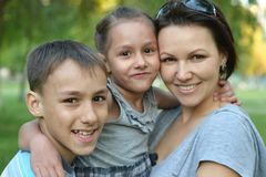 Mother With Her Children In Summer Park Stock Photos