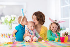 Mother With Three Children Painting Easter Eggs Stock Photography