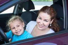 Mother With Young Daughter Sitting Together On Driver Seat In Car Royalty Free Stock Photo