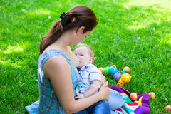 Mother woman breastfeeding baby boy kid Stock Photo