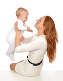 Mother woman holding in her arms child baby kid girl fan with ru Royalty Free Stock Photo