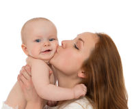 Mother woman kissing in her arms infant child baby kid. Young mother women holding and kissing in her arms infant child baby kid girl toddler in diaper on a Royalty Free Stock Images