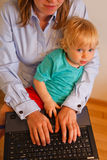 Mother work home. Businesswomen with baby working on laptop from home Royalty Free Stock Images