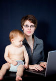 Mother working with her baby royalty free stock photos