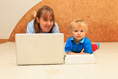 Mother working from home Stock Photography