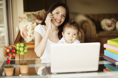 Mother working with kid Stock Image