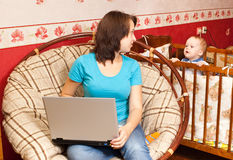 Mother works at home Royalty Free Stock Photo