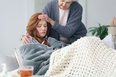 Mother worried about sick daughter. With fever during seasonal virus infection Stock Images