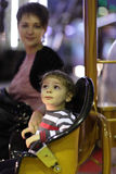 Mother woth her son on carousel Stock Image