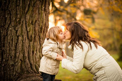 Mother's sunset kiss Stock Image