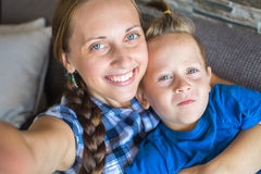 Mother And 4 years old Son Posing For Selfie Stock Images