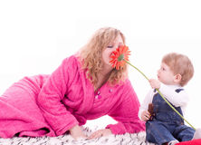 Mother and young baby boy with red flower Stock Photos