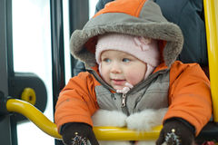 Mother with young baby stay near bus doors Stock Image