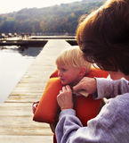 Mother and young child on dock Stock Image