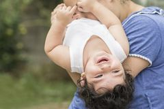 Mother and young child playing together in outdoor environment. Togetherness concept, playful and enjoyment stock image