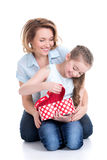 Mother and young daughter looking into the box with gift Royalty Free Stock Image