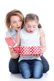 Mother and young daughter looking into the box with gift Royalty Free Stock Photos