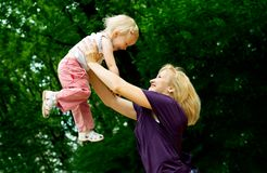 Mother with young daughter in the park Stock Images