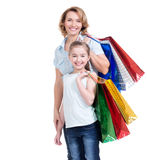 Mother and young daughter with shopping bags Royalty Free Stock Images