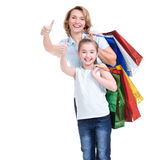 Mother and young daughter with shopping bags Royalty Free Stock Photography