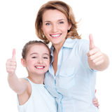 Mother and young daughter with thumbs up Royalty Free Stock Photos