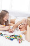 Mother and young daughter together smiling Stock Image