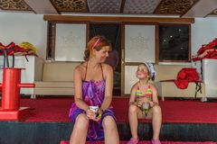 Mother and young daughter are traveling in the Mediterranean sea on the ship Royalty Free Stock Photo