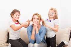 Mother and young daughters having fun at home Royalty Free Stock Photo