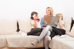 Mother and young daughters shopping online concept Royalty Free Stock Photos
