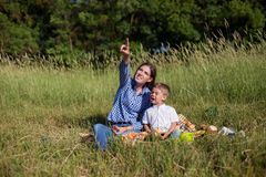 Mother and young son look in the sky stock image