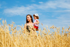 Motherand daughter in a wheat field Stock Photo