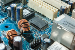 Motherboard capacitor. And transitor close up Stock Photography
