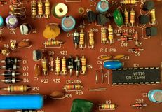 Motherboard chip electronical equipment. Motherboard chip close-up with details on brown background. Electronical equipment, robots Royalty Free Stock Photography