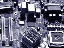 Motherboard Components. The background of a computer motherboard in dark blue tone Royalty Free Stock Image