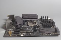 Mother board computer circuit. Motherboard computer circuit on a gray background stock images