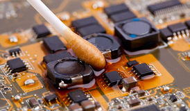 Motherboard with cotton stick Royalty Free Stock Photos