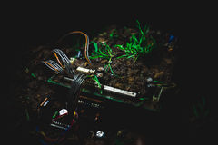 Motherboard in the dirt Royalty Free Stock Photos