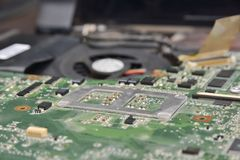 Motherboard and fan cooler Royalty Free Stock Photos