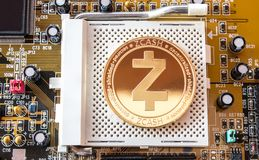 Crypto currency gold coin zcash on a motherboard Royalty Free Stock Photography